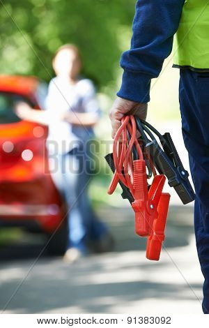 Mechanic Attending Car Breakdown On Country Road