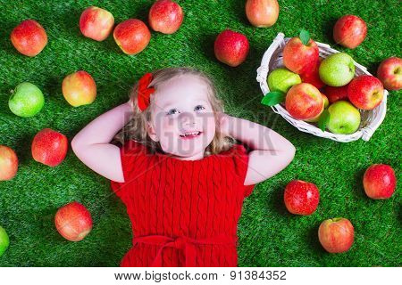 Little Girl Eating Apples