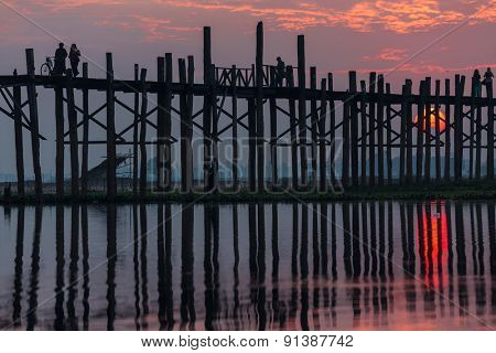 U bein wooden teck bridge under red sunset in Myanmar