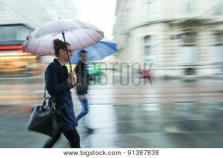 Woman And Man In The Rain