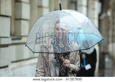 Woman With Umbrella On Street