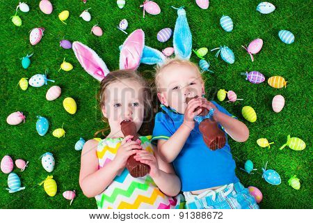 Kids Eating Chocolate Rabbit On Easter Egg Hunt