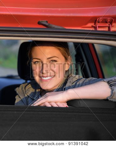 Smiling Woman Sitting In Car.