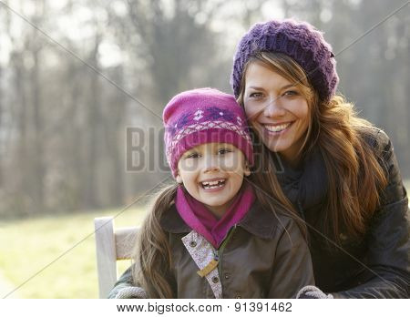 Portrait mother and daughter outdoors in winter