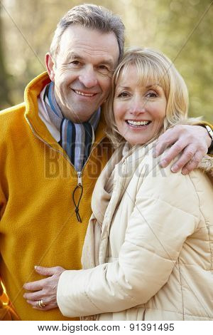 Senior couple portrait outdoors in winter