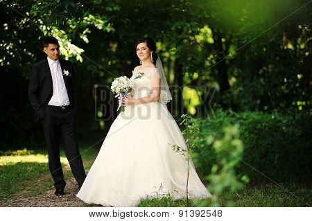 Happy Wedding Couple At The Forest