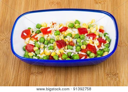 Vegetable Mix In Blue Bowl On Bamboo Board
