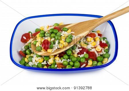 Vegetable Mix In Blue Bowl And Bamboo Spoon