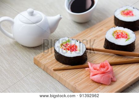 Sushi rolls with ginger, soy sauce and chopsticks