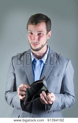Portrait of young handsome man holding empty wallet