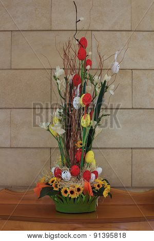 Easter Composition With Eggs, Flowers And Twigs On The Table