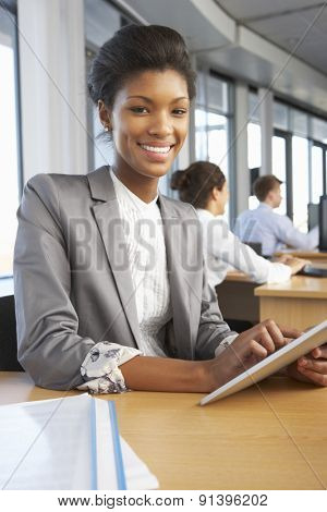 Smiling Worker In Busy Office