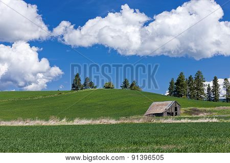 Barn And Clouds In The Sky.