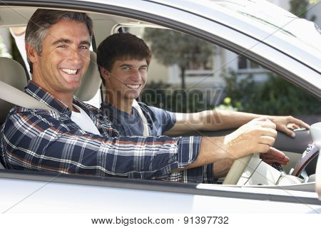 Father On Car Journey With Teenage Son