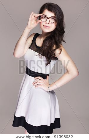 Beautiful Brunette Caucasian Business Woman In Classic Dress And Glasses. Neutral Grey Background