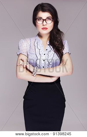 Beautiful Brunette Caucasian Business Woman In Classic Dress And Glasses Looks Like Teacher. Neutral