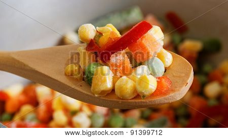 Closeup Spoon With Frozen Mixed Vegetables