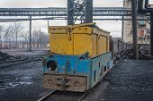foto of stagnation  - Train in national colors with trolleys in a coal mine - JPG