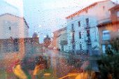 pic of rainy day  - Street view through the wet glass in rainy day - JPG