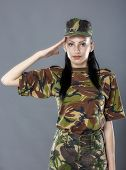 stock photo of army soldier  - Woman army soldier saluting isolated on gray background - JPG