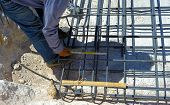 picture of measuring height  - worker measure the distance between the steel reinforcement - JPG
