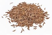image of cumin  - Heap of cumin seeds on a white background - JPG