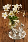image of windflowers  - White anemones and two glass cups and saucers on wooden background vertical - JPG