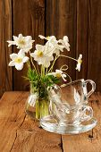 picture of windflowers  - White anemones and two glass cups and saucers on wooden background copyspace vertical - JPG