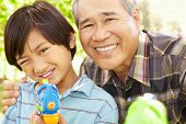 picture of pistols  - Boy and grandfather with water pistols - JPG