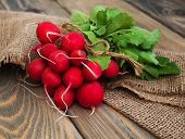 stock photo of radish  - Fresh organic radish on a old wooden background - JPG