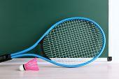 pic of shuttlecock  - Tennis racket and shuttlecocks on blackboard background - JPG