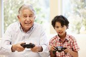 picture of grandfather  - Grandfather and grandson playing computer games - JPG