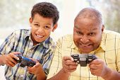 image of grandfather  - Grandfather and grandson playing computer games - JPG
