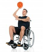 picture of handicap  - Handicapped Basketball Player On Wheelchair Throwing Ball Over White Background - JPG