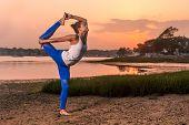 foto of tantric  - Yoga Model Doing Natarajasana Variation Dancer Pose On Beach - JPG