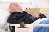 image of hospital gown  - Senior man in hospital bed - JPG