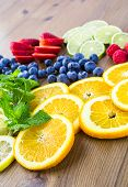 foto of infusion  - Sliced fresh organic fruits prepared to make infused water. ** Note: Shallow depth of field - JPG