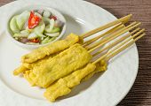 stock photo of sate  - Food and Cuisine Grilled Pork Satay on Bamboo Skewer Served with Cucumber Salad - JPG