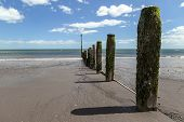image of sea-scape  - Shot of a beach on a sunny day looking out to the sea - JPG