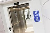 pic of disabled person  - Elevator for mothers and children and physically disabled people in wheelchairs - JPG