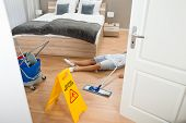 stock photo of maids  - Female Maid Had Accident At Work While Cleaning Hotel Room - JPG