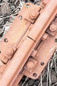 stock photo of bolt  - Bolts rusted tracks - JPG