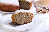 picture of icing  - Poppy seed and raisin ring cake with icing sugar on top - JPG