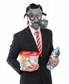 stock photo of gas mask  - Survival concept business man with gas mask isolated on white - JPG