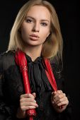 stock photo of sadistic  - beautiful woman with chic lips in biting red whip - JPG