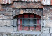 pic of basement  - Medieval grilled basement window of the old house in Russia - JPG