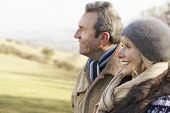 stock photo of maturity  - Mature couple on country walk in winter - JPG