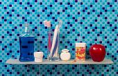 image of personal hygiene  - Personal hygiene products on glass shelve and blue background - JPG