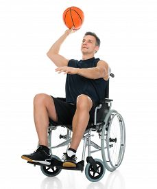 image of handicapped  - Handicapped Basketball Player On Wheelchair Throwing Ball Over White Background - JPG