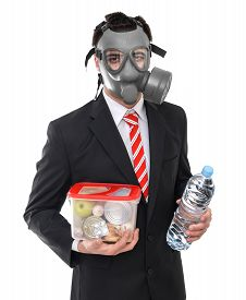pic of doomsday  - Survival concept business man with gas mask isolated on white - JPG